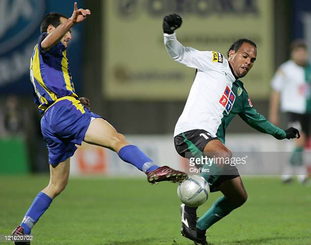 Uniao's Alex Garcia in action against Sporting's Alecssandro during the Portuguese Cup fourth round match between União da Madeira and Sporting...