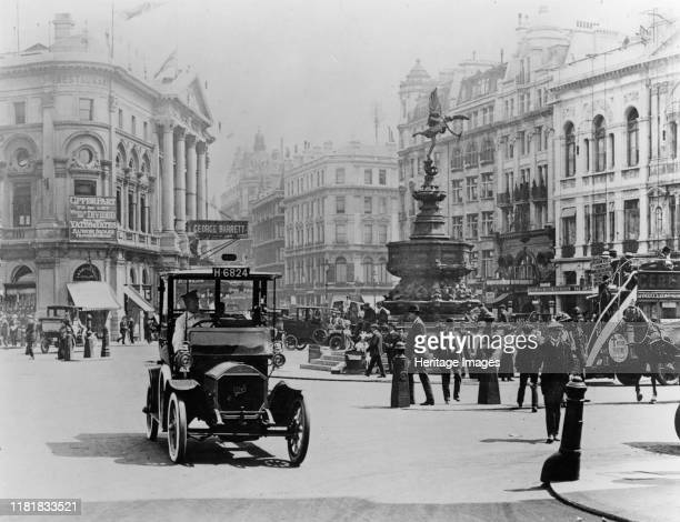 Unic taxi in Piccadilly circus, London circa 1910. Creator: Unknown.