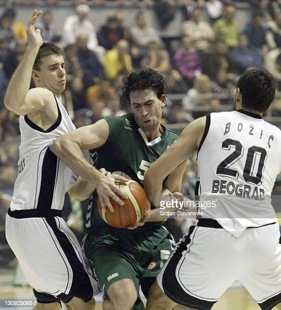 Unicaja Malaga player Rodriguez Bernardo center is fouled by Petar Bozic right and Uros Tripkovic left from Partizan during their group B Euroleague...