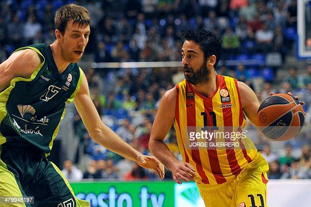 Unicaja's center Fran Vazquez vies with Barcelona's guard Juan Carlos Navarro during the Euroleague group E TOP 16 basketball match Unicaja Malaga vs...