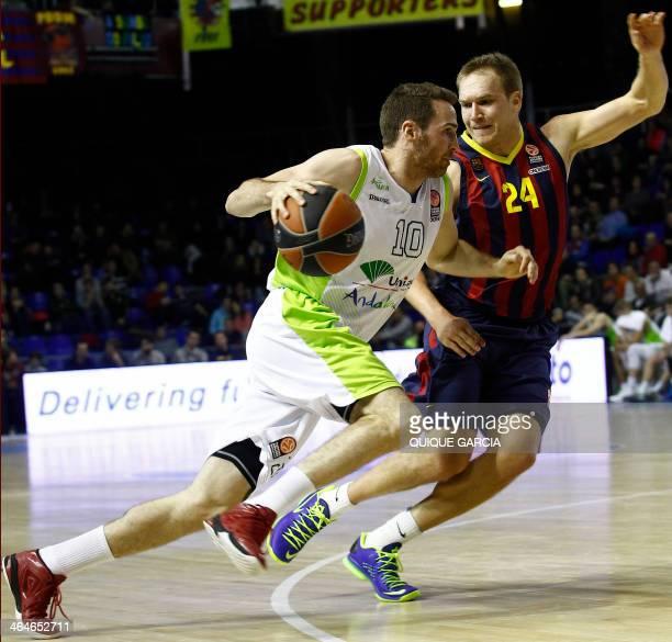 Unicaja's guard Txemi Urtasun vies with Barcelona's US guard Bardley Scott Oleson during the Euroleague top 16 round 4 basketball match FC Barcelona...