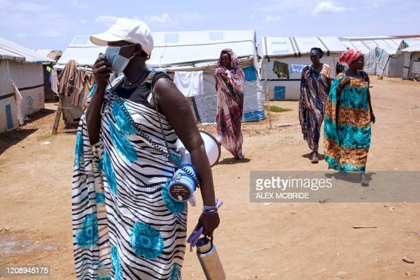 Unicef social mobilizer uses a speaker as she carries out public health awareness to prevent the spread and detect the symptoms of the COVID-19...