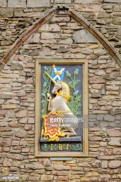unicorn and thistle of king james v, holyrood palace, edinburgh, scotland - holyrood palace stock pictures, royalty-free photos & images