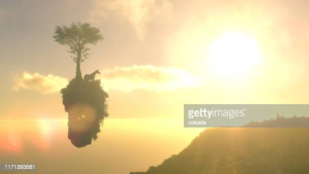 unicorn on a floating island - fictional character stock pictures, royalty-free photos & images