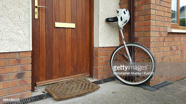 Unicycle With Helmet Outside House