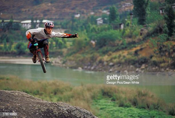 Unicyclist in the air
