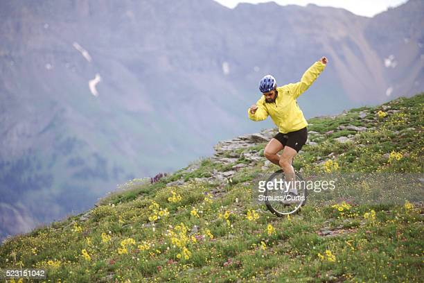 Unicyclist on a rugged hill
