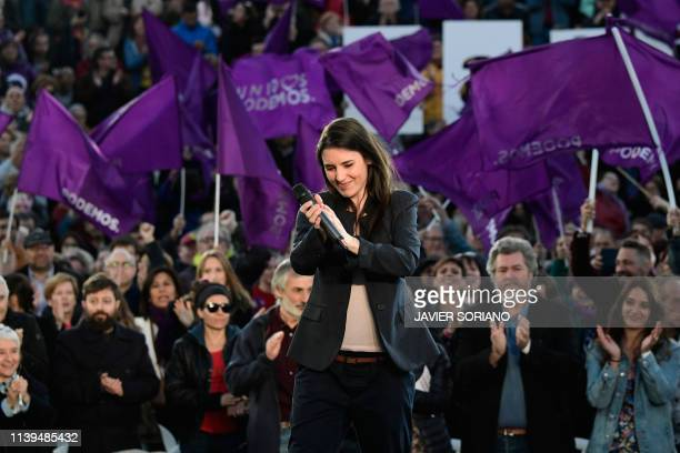 Unidas Podemos coalition's candidate Irene Montero claps during their last campaign rally in Madrid on April 26 2019 ahead of the April 28 general...