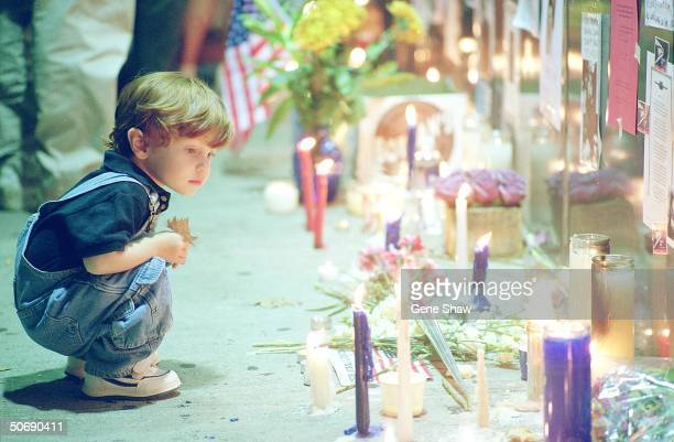 Unident child viewing memorial at Union Square Park after World Trade Center Tragedy