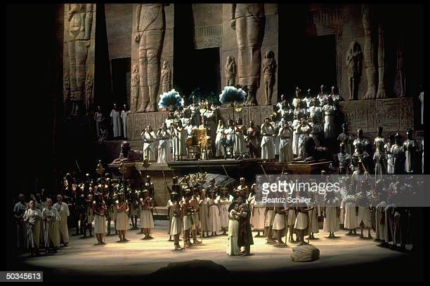 Unident singers as Aida Radames embrace amidst chorus in scene fr Verdi's Aida on stage at the Metropolitan Opera