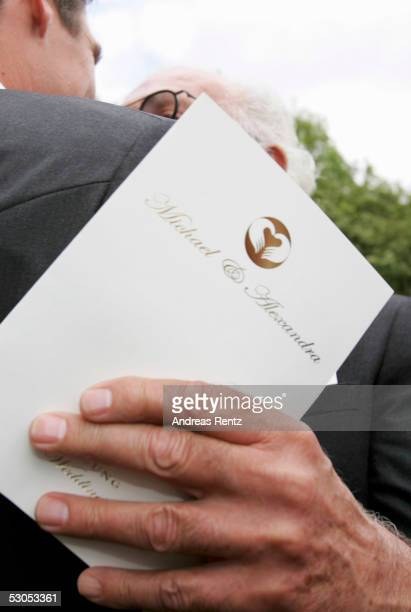 A unidentfied guest holds the wedding invatation at the Sankt Severin church on June 11 2005 at Sylt in Germany Michael Stich and Alexandra Rikowski...