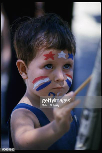 Unidentifed little boy sporting red, white and blue face paint in honor of the American bicentennial.