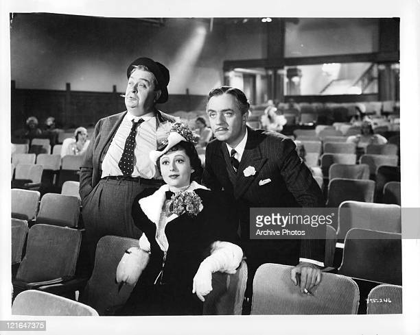 Unidentified actor Luise Rainer and William Powell watch screening in a scene from the film 'The Great Ziegfeld' 1936