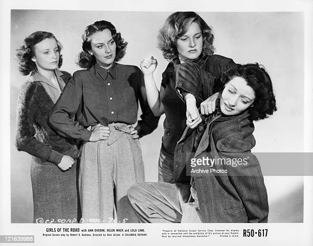 Unidentified actress and Ann Dvorak watch Lola Lane about to punch unidentified woman in a scene from the film 'Girls Of The Road' 1940