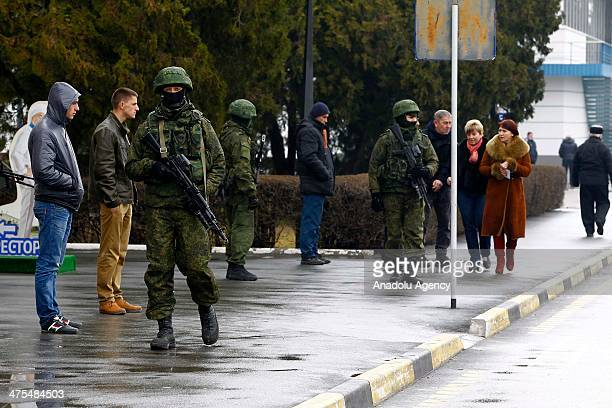 Unidentified armed men patrol a square in front of the International Airport in Simferopol Ukraine on February 28 2014 Dozens of armed men in...