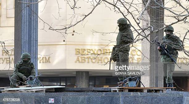 Unidentified armed men patrol in front of the Crimean Parliament in Simferopol on March 01 2014 ProRussian forces tightened their grip on Crimea on...