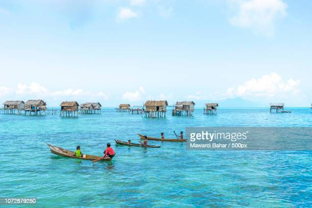 sabah, malaysia - august 15, 2015: unidentified bajau laut kids on a boat in bodgaya island, sabah, - bajau stock pictures, royalty-free photos & images