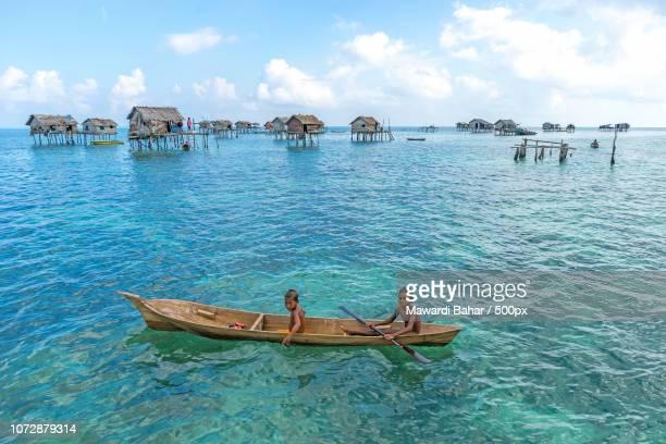 SABAH, MALAYSIA - AUGUST 15, 2015: Unidentified Bajau Laut kids on a boat in Bodgaya Island, Sabah,