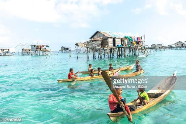 SABAH, MALAYSIA - AUGUST 17, 2016 : Unidentified Bajau Laut kids on a boat in Bodgaya Island, Sabah,