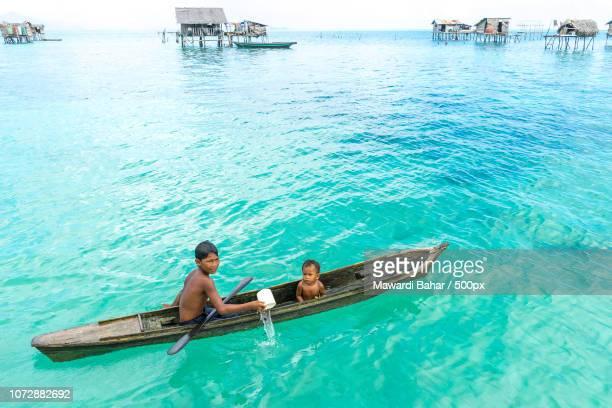 SABAH, MALAYSIA - AUGUST 15, 2016 : Unidentified Bajau Laut kids on a boat in Bodgaya Island, Sabah,