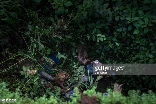 Unidentified bodies believed to have been executed by armed militants lie dumped in a ditch on May 28 2017 in Marawi city southern Philippines The 8...