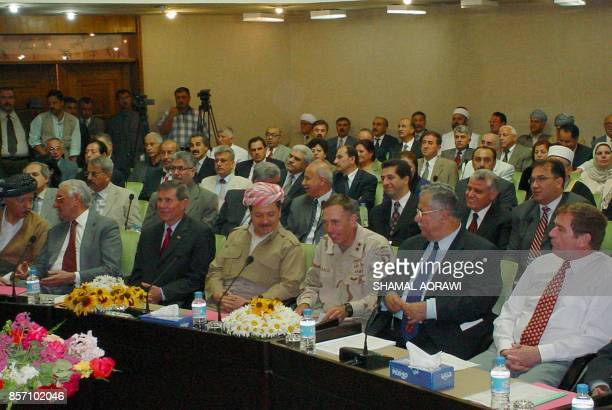 Unidentified British and US officials meet with members of Iraqi Kurdistan's regional parliament in the northern city of Arbil 09 June 2003 on the...