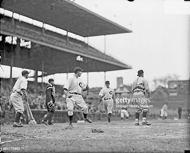 Unidentified Chicago Cubs baseball player crossing home plate during a game versus the Pittsburgh Pirates at Wrigley Field located at 1060 West...