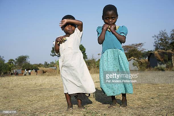 Unidentified children walk to a preschool for orphans on August 20 2006 in Mphandula village about 30 miles outside Lilongwe Malawi Mphandula is a...