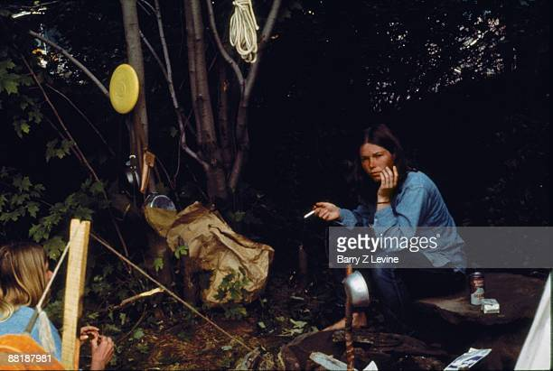 Unidentified concertgoers sit at a campsite on the grounds of the Woodstock Music and Arts Fair in Bethel New York August 15 17 1969