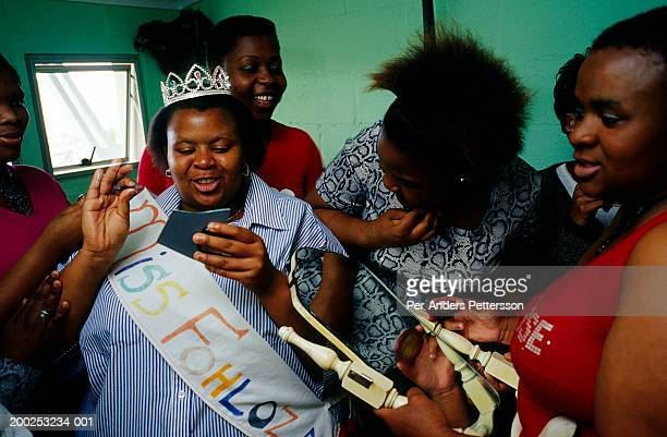Unidentified contestants in Miss Fohloza competition put on their makeup backstage on August 28 2001 in Site B Khayelitsha a township outside Cape...