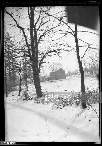 Unidentified distant house in snow Photo shot at canted angle New York New York late 19th or early 20th century