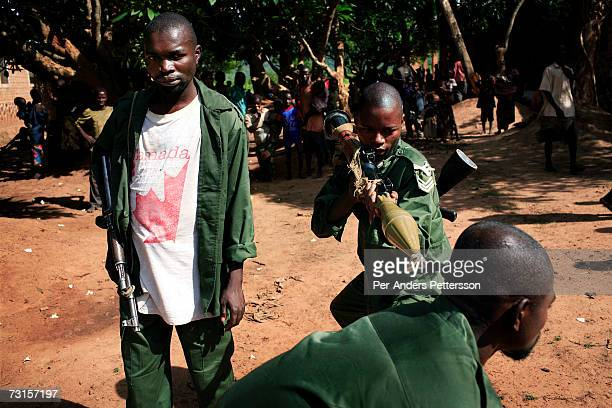 Unidentified drunk Congolese army soldiers pose for pictures outside a military base on December 10 2005 in Dubie Katanga Province in Congo...