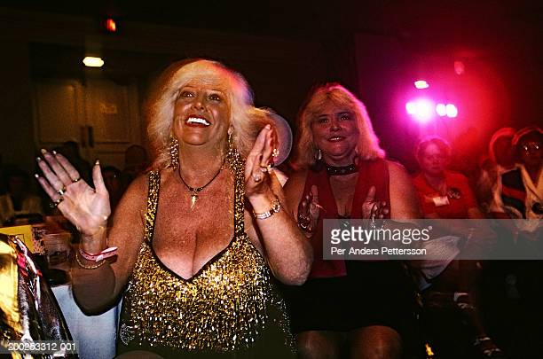 Unidentified Elvis Presley fans watch an Elvis impersonator perform in a bar on August 10 1998 in Memphis TN USA Elvis Presley died in August 1977...