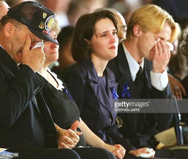 Unidentified family members cry at a ceremony 13 August at Andrew AFB in Maryland honoring the men and women who lost their lives in last weeks...