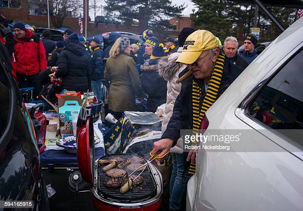 Unidentified fans and alumni of the University of Michigan and Ohio State University socialize with tailgate parties before the Big Ten football...