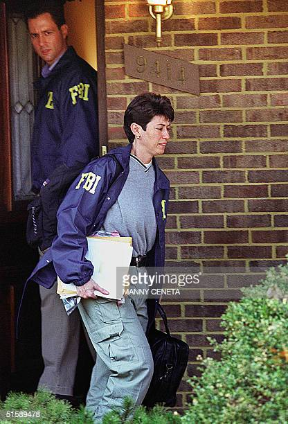 Unidentified Federal Bureau of Investigation investigators leave the house of alleged spy and veteran FBI agent Robert Philip Hanssen in Vienna...