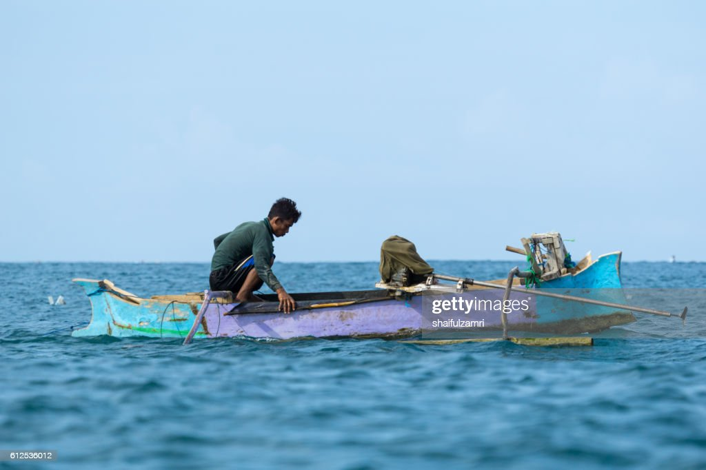 Unidentified fisherman ready to work in the boat early morning. : Stock Photo