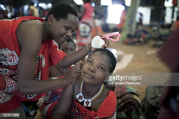 Unidentified girls dress and prepare before a traditional Reed dance ceremony at the Royal Palace on August 30 in Ludzidzini Swaziland About 80000...