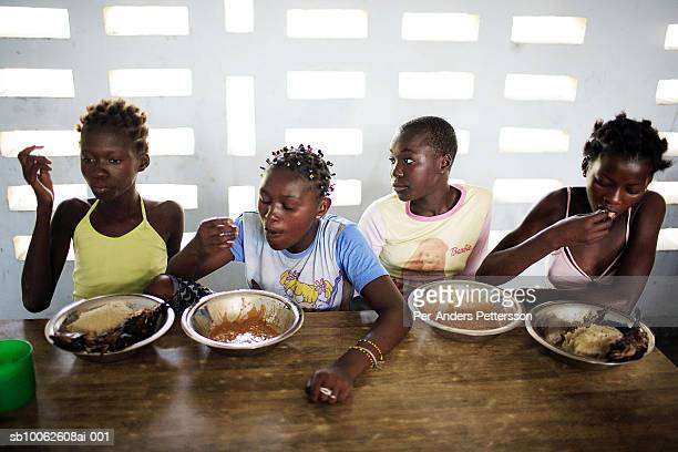 Unidentified girls eat lunch at a yearly summer camp run by Orper a local NGO on July 4 2006 in N Djili outside Kinshasa Congo DRC The NGO has...