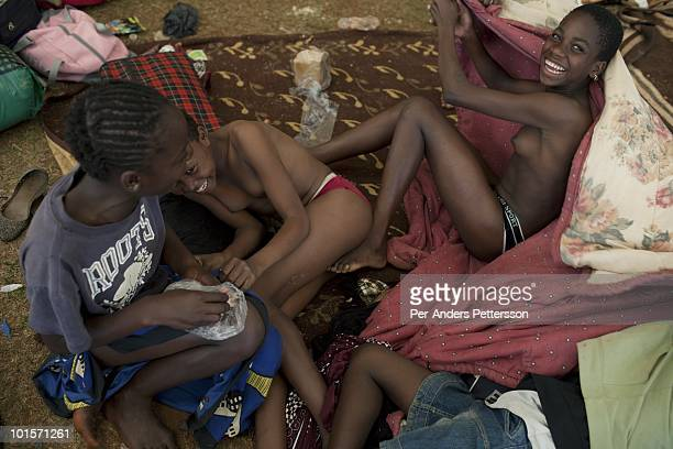 Unidentified girls play before a traditional Reed dance ceremony at the Royal Palace on August 29 in Ludzidzini Swaziland About 80000 virgins from...