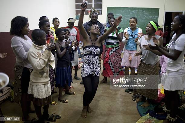 Unidentified girls practice their dances in a class room before a traditional Reed dance ceremony at the Royal Palace on August 29 in Ludzidzini...