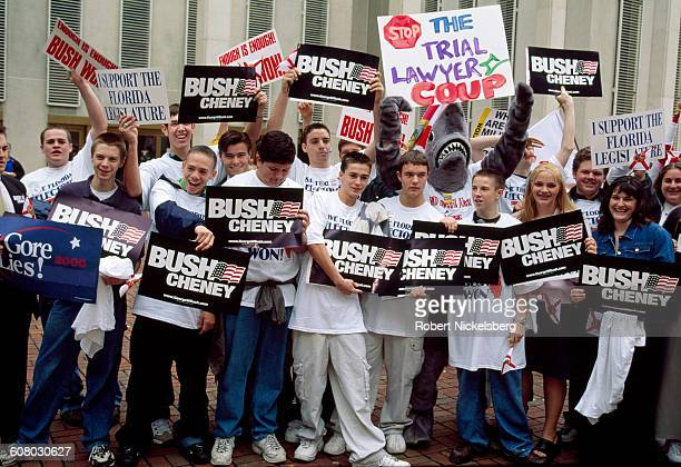 Unidentified Governor George W Bush and Dick Cheney supporters cheer outside the Seminole County court house in Tallahassee Florida as the decision...