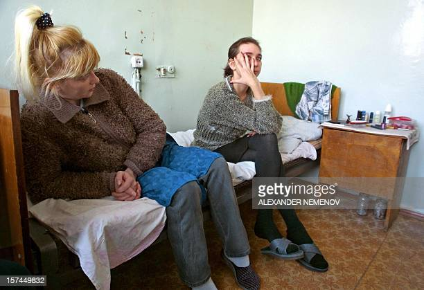 Unidentified HIV infected patients sit in their room in a special AIDS clinic in Irkutsk Siberia 11 December 2000 Irkutsk lies third behind the...