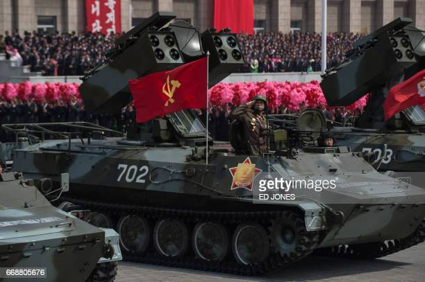 Unidentified Korean People's Army mobile missile launchers are displayed during a military parade marking the 105th anniversary of the birth of late...