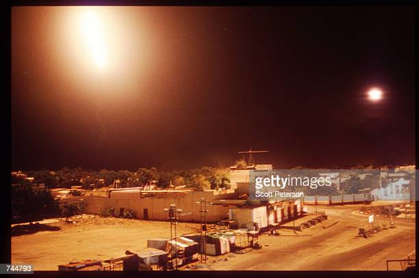 Unidentified lights illuminate the night sky June 20 1993 in Mogadishu Somalia An estimated 350000 Somalis died due to war famine and disease over...