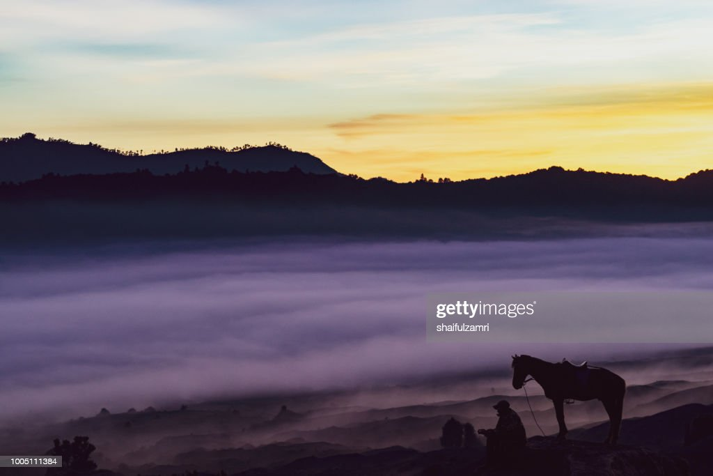 Unidentified local people or Bromo Horseman at the mountainside of Mount Bromo with noise and : Stock Photo