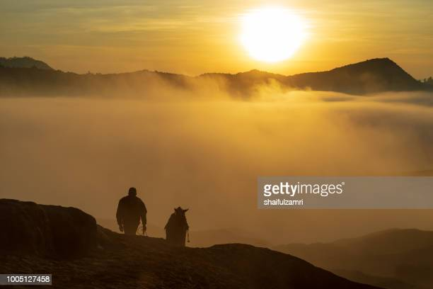 unidentified local people or bromo horseman at the mountainside of mount bromo, semeru, tengger national park, east java of indonesia. - shaifulzamri stock pictures, royalty-free photos & images