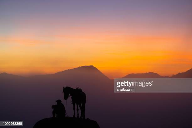 Unidentified local people or Bromo Horseman at the mountainside of Mount Bromo, Semeru, Tengger National Park, East Java of Indonesia.