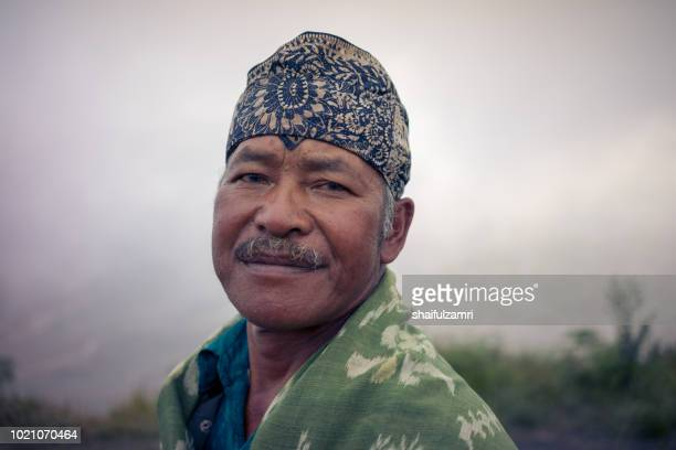 unidentified local people pose for camera at the mountainside of mount bromo, semeru, tengger national park, east java of indonesia. - shaifulzamri stock pictures, royalty-free photos & images