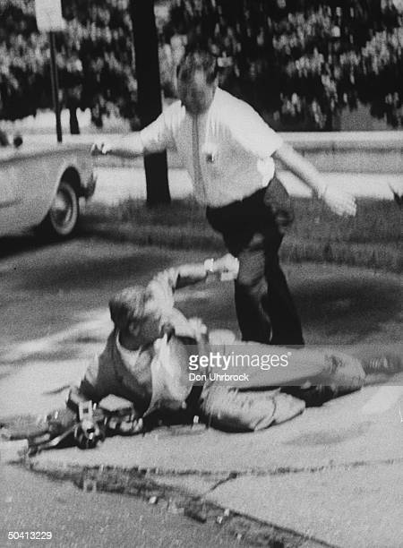 Unidentified man being kicked by police during Freedom Rider demonstrations